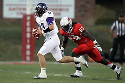 21 September 2013:  John Dave Baker is sought after by Rickey Simpson during an NCAA football game between the Abilene Christian Wildcats and the Illinois State Redbirds at Hancock Stadium in Normal IL