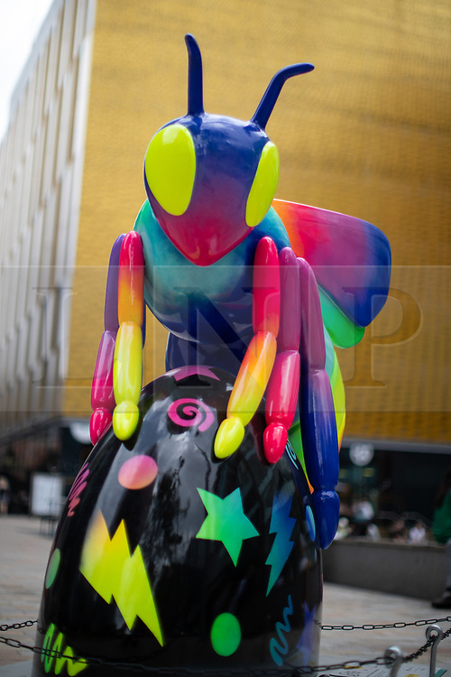 "© Licensed to London News Pictures . 26/07/2018. Manchester , UK . Bee in the City sculpture outside HOME . ""Bee-bop-a-raver"" by Caroline Daly . Over 100 bee sculptures , decorated and painted by different artists , have been placed across Manchester City Centre . The worker bee is Manchester's symbol , reflecting the City's heritage as the home of the industrial revolution . Photo credit : Joel Goodman/LNP"