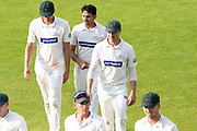 Chris Wright Muhammad Abbas & Dieter Klein leave the field at the end of the Northants innings during the Specsavers County Champ Div 2 match between Northamptonshire County Cricket Club and Leicestershire County Cricket Club at the County Ground, Wantage Road, Abingdon, United Kingdom on 24 June 2019.