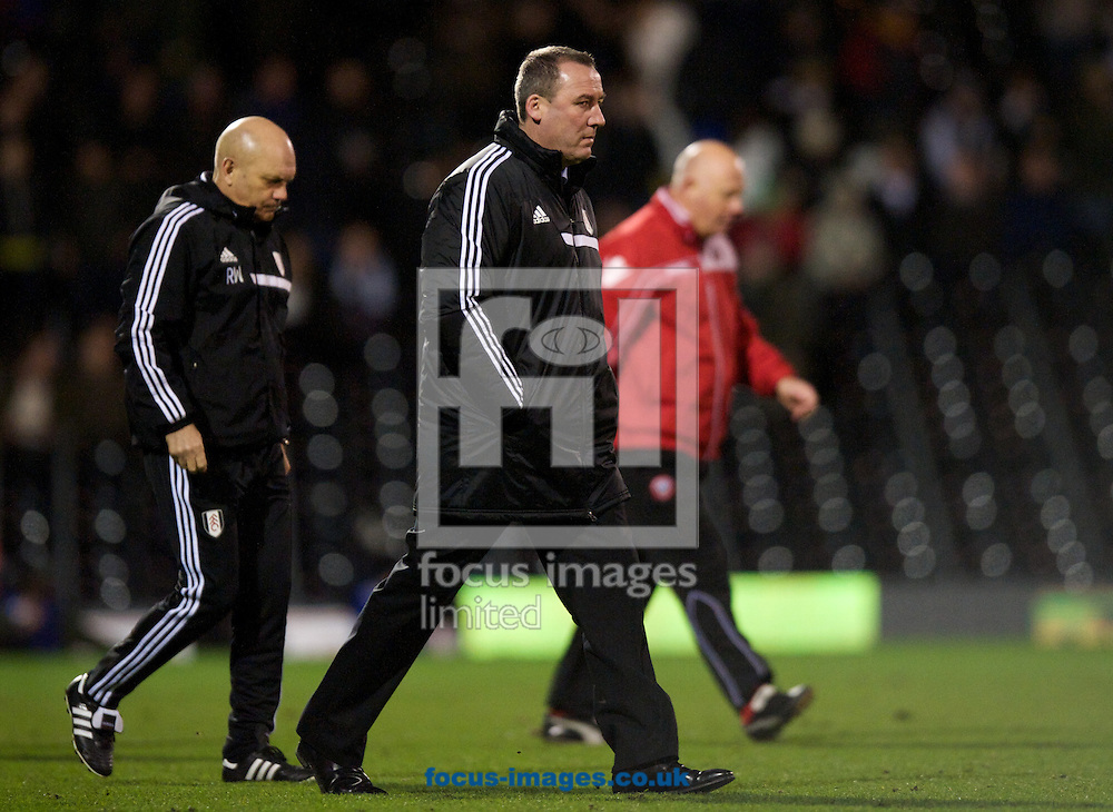 Picture by Alan Stanford/Focus Images Ltd +44 7915 056117<br /> 04/02/2014<br /> Manager Rene Meulensteen of Fulham and assistant head coach Ray Wilkins leave the pitch after their 0-1 loss in the The FA Cup match at Craven Cottage, London