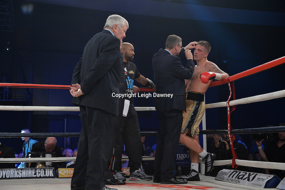 Matty Clarkson is checked by the doctor following his defeat by Bob Ajisafe for the Maxi Nutrition Knockout at Glow, Bluewater, Kent on the 8th November 2014. Promoter: Hennessy Sports. © Leigh Dawney Photography 2014.