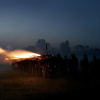 Union soldiers fire a volley at a confederate unit during the sunrise battle, a reenactment of the Battle of Pottsville, during the weekend celebration of the Battle of Perryville, which serves as the national Civil War reenactment for 2006, at the Perryville Battlefield in Perryville, Ky. on Oct. 7, 2006. David Stephenson/Staff