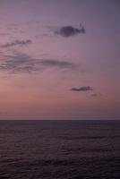 Pastel colored sky and clouds over the Pacific Ocean at dawn.  Image 17 of 21  for a panorama taken with a Fuji X-T1 camera and 35 mm f/1.4 lens  (ISO 400, 35 mm, f/2.8, 1/30 sec). Raw images processed with Capture One Pro and stitched together with AutoPano Giga Pro.