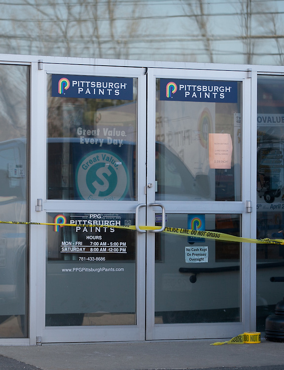 Needham, MA 03/27/2012.The door of Pittsburgh Paints is wrapped in crime scene tape after an armed robbery there on Tuesday afternoon..Wicked Local Photo by Alex Jones