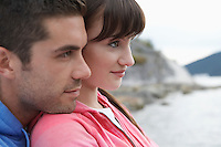 Pensive couple at ocean close-up