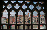 A view of the Grand Canal seen through a palazzo facade in Venice.
