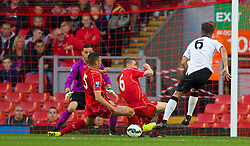 ANFIELD, ENGLAND - Friday, August 22, 2014: Liverpool's captain Lloyd Jones and Jordan Rossiter block a shot from Manchester United's Josh Harrop during the Under 21 FA Premier League match at Anfield. (Pic by David Rawcliffe/Propaganda)