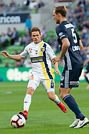 Central Coast Mariners midfielder Michael McGlinchey (8) watches on at the Hyundai A-League Round 4 soccer match between Melbourne Victory and Central Coast Mariners at AAMI Park in Melbourne.