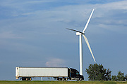BROOKSTON, IN - JULY 8: General view of a semi-trailer truck traveling on Interstate 65 past a wind turbine near the Meadow Lake Wind Farm owned by Horizon Wind Energy on July 8, 2010 in Brookston, Indiana. (Photo by Joe Robbins)