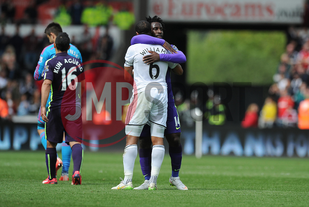Swansea City's Ashley Williams embraces Manchester City's Wilfried Bony at full time. - Photo mandatory by-line: Alex James/JMP - Mobile: 07966 386802 - 17/05/2015 - SPORT - Football - Swansea - The Liberty stadium - Swansea City v Manchester City - Barclays premier league