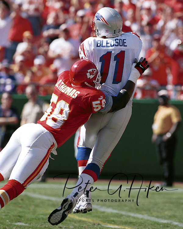 Kansas City's Derrick Thomas (58) dives into New England quarterback Drew Bledsoe (11) at Arrowhead Stadium in Kansas City, Missouri on October 10, 1999.