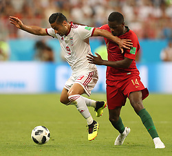 SARANSK, June 25, 2018  William Carvalho (R) of Portugal vies with Omid Ebrahimi of Iran during the 2018 FIFA World Cup Group B match between Iran and Portugal in Saransk, Russia, June 25, 2018. (Credit Image: © Fei Maohua/Xinhua via ZUMA Wire)