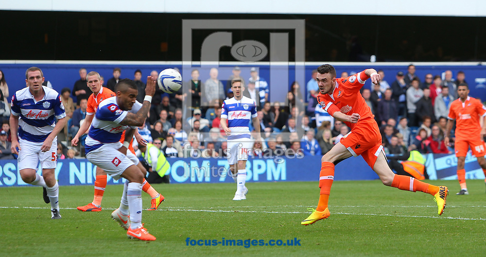 Scott Malone of Millwall scores the equaliser during the Sky Bet Championship match at the Loftus Road Stadium, London<br /> Picture by John Rainford/Focus Images Ltd +44 7506 538356<br /> 26/04/2014
