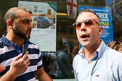 © Licensed to London News Pictures. 02/06/2019. London, UK. A protesters speaks with Danny Tommo (real name Daniel Thomas) an associate of Tommy Robinson. <br /> Protesters take part in the annual Al Quds day protest and march from Home Office to Whitehall in central London. Al-Quds Day, an annual day of protest decreed in 1979 by the late Iranian ruler Ayatollah Khomeini, is celebrated to express support for the Palestinian people and their resistance against Israeli occupation. A counter demonstration by Israel supporters takes place. Photo credit: Dinendra Haria/LNP