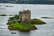 "1440s Castle Stalker is a 4-story tower house or keep picturesquely set on a tidal islet on Loch Laich, an inlet of Loch Linnhe, near Port Appin, Argyll, in Scotland, United Kingdom, Europe. Castle Stalker is visible from the A828 road midway between Oban and Glen Coe. It was occupied from the 1440s-1840, lost its roof, then was fully restored 1965-1974. It appeared in the 1975 film ""Monty Python and the Holy Grail"" in the final scene as ""The Castle of Aaaaarrrrrrggghhh."" The name Stalker comes from the Gaelic Stalcaire, meaning hunter or falconer."