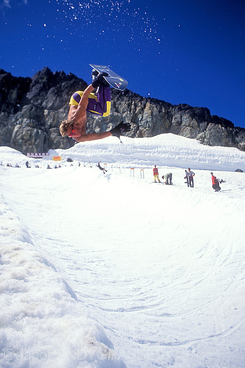 Jimi Scott gets upside down with a shirtless Crippler on the Blackcomb Glacier in 1991.