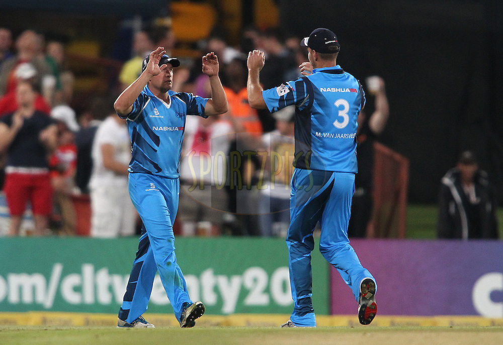 Roelof van der Merwe of the Titans is congratulated by Titans captain Martin van Jaarsveld for taking the catch to get Ben Rohrer of the Sydney Sixers wicket during the 2nd semi final of the Karbonn Smart CLT20 South Africa between The Sydney SIxers and the The Titans held at Supersport Park in Centurion, Gauteng on the 26th October 2012..Photo by Shaun Roy/SPORTZPICS/CLT20.