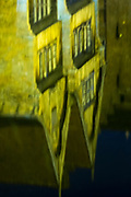 Reflection in canal water of famous picturesque scene of medieval buildings at the Rozenhoedkaai in Bruges, Belgium