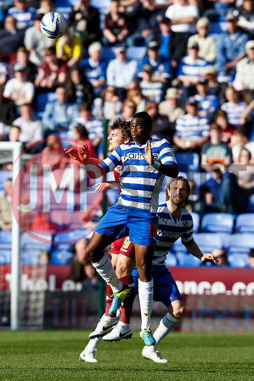 Reading Midfielder Hope Akpan (ENG) and Derby Forward Chris Martin (ENG) compete in the air - Photo mandatory by-line: Rogan Thompson/JMP - 07966 386802 - 15/09/2014 - SPORT - FOOTBALL - Madejski Stadium - Reading - Reading v Derby County - Sky Bet Football League Championship.
