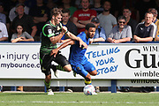 AFC Wimbledon striker Andy Barcham (17) battles for possession with during the EFL Sky Bet League 1 match between AFC Wimbledon and Doncaster Rovers at the Cherry Red Records Stadium, Kingston, England on 26 August 2017. Photo by Matthew Redman.