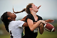 Xavier Mascareñas/Treasure Coast Newspapers; Fort Pierce Westwood's Daphne Gabriel, left, collects a pass interference call while trying to defend against a pass to Vero Beach's Katie Wheeler during the first half of the District 20 girls flag football championship game at Fort Pierce Central High School in Fort Pierce on Tuesday, April 29, 2014.