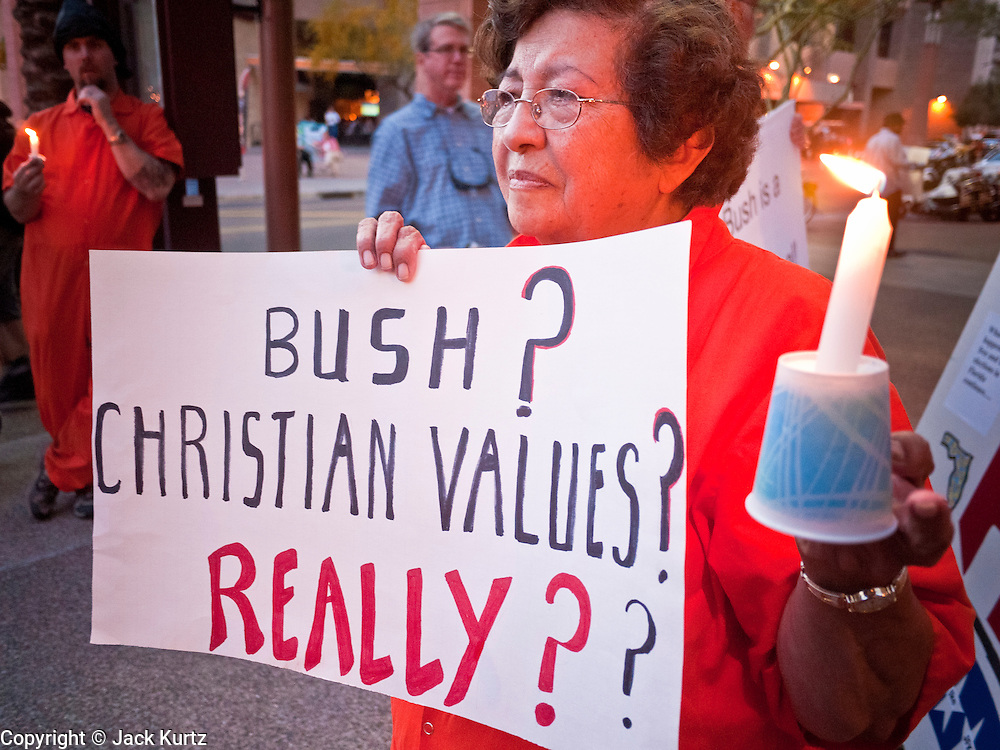 16 MARCH 2011 - PHOENIX, AZ: Celia Arambula participates  in candlelight protest against former Pres George W, Bush Wednesday night. Former president George W. Bush spoke at Arizona Christian University's 50th anniversary dinner at the Phoenix Convention Center Wednesday night. Hundreds of people from progressive and social justice groups demonstrated against the former president.   PHOTO BY JACK KURTZ