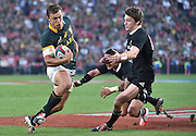 JOHANNESBURG, South Africa, 04 October 2014 : Handré Pollard of the Springboks gets past Aaron Smith and Beauden Barrett of the All Blacks for his second try during the Castle Lager Rugby Championship test match between SOUTH AFRICA and NEW ZEALAND at ELLIS PARK in Johannesburg, South Africa on 04 October 2014. <br /> The Springboks won 27-25 but the All Blacks successfully defended the 2014 Championship trophy.<br /> <br /> © Anton de Villiers / SASPA