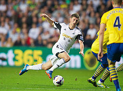 SWANSEA, WALES - Saturday, September 28, 2013: Swansea City's Ben Davies in action against Arsenal during the Premiership match at the Liberty Stadium. (Pic by David Rawcliffe/Propaganda)