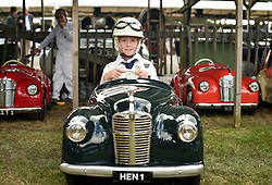 © licensed to London News Pictures. 12/09/2015<br /> Goodwood Revival Weekend, Goodwood, West Sussex. UK.<br /> The Goodwood Revival is the world's largest historic motor racing event. Competitors and enthusiasts dress in period fashions recreating the glorious days of the race circuit.<br /> Pictured 9 year old Henry Alexander in his Austin J40 peddle car.<br /> <br /> Photo credit : Ian Whittaker/LNP