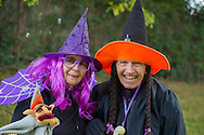 Merrick, New York, USA. October 29, 2016. BETTY TUCKER and her husband LENNY TUCKER, of Merrick, are dressed in witches costumes at the 2016 annual Merrick Spooktacular hosted in part by the North and Central Merrick Civic Association (NCMCA). Betty is a member of the Merrick American Legion Auxilliary 1282, and Marty is a member of the American Legion Post 1282, which sponsored the holiday party at Fraser Park.