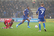 AFC Wimbledon defender Paul Kalambayi (30) tackling Lincoln City midfielder Jorge Grant (18) during the EFL Sky Bet League 1 match between AFC Wimbledon and Lincoln City at the Cherry Red Records Stadium, Kingston, England on 2 November 2019.