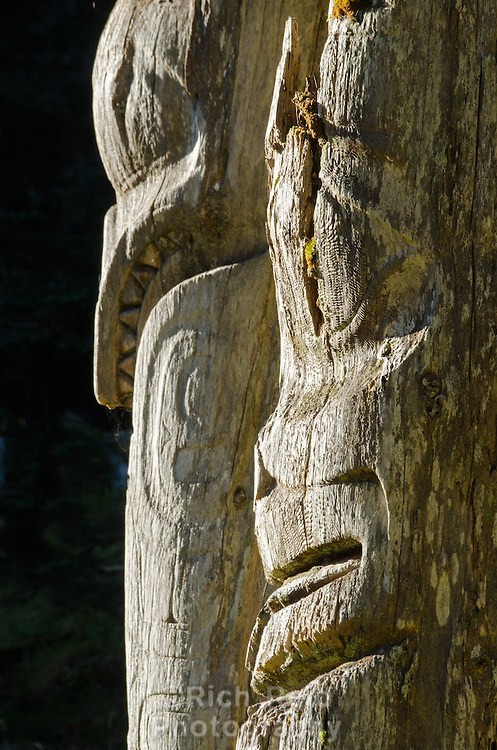 Killer Whale and Grizzly Bear totem detail at SGang Gwaay Lingagaay National Historic Site on Haida Gwaii, British Columbia, Canada. A UNESCO World Heritage Site protecting a Northwest Coast First Nations village site.