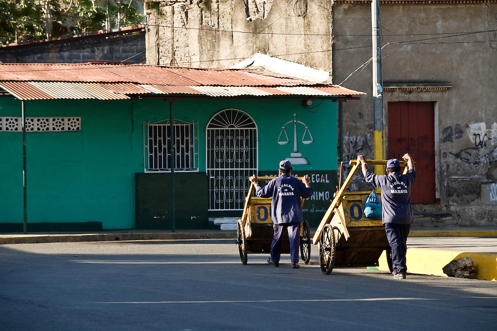 Municipal cleaners in Masaya. Masaya is located close to Granada, Nicaragua. It is a regional transportation hub and a famous market town where the products of the artisans of the surrounding towns are sold.