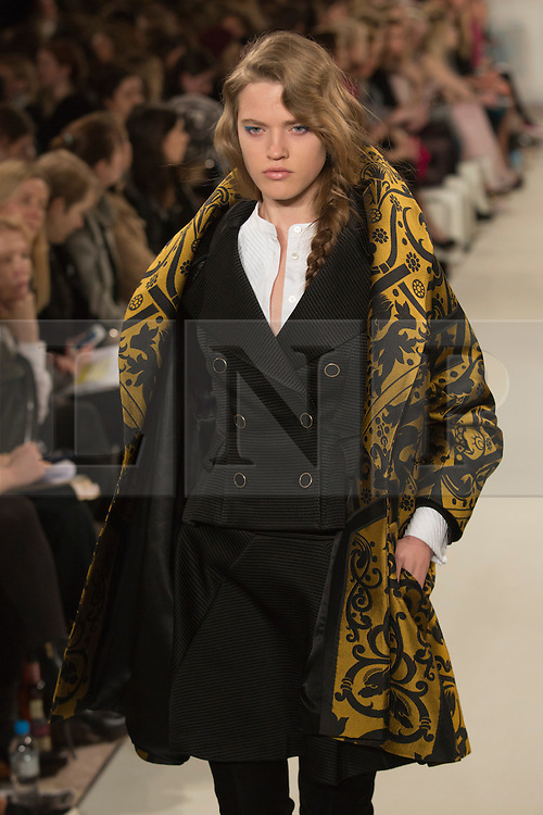 © Licensed to London News Pictures. 16 February 2014, London, England, UK. A model walks the runway at the Temperley show during London Fashion Week AW14 at The Savoy Hotel. Photo credit: Bettina Strenske/LNP