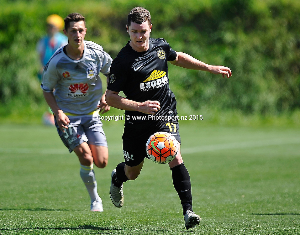 Fergus Neil of Team Wellington dribbles the ball during the ASB Premiere  - Team Wellington vs Phoenix football match at David Farrington Park in Wellington on Sunday the 20th of December 2015. Copyright Photo by Marty Melville / www.Photosport.nz