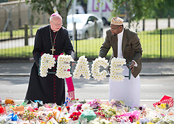 © London News Pictures. 31/05/2013. The retired Archbishop of Southwark Kevin McDonald (L) and Imam Ali of Woolwich lay a wreath of 'peace' at the site where soldier Lee Rigby was murdered outside the Royal Artillery Barracks at Woolwich in London. Photo credit: Ben Cawthra/LNP