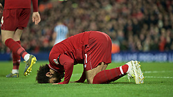 LIVERPOOL, ENGLAND - Friday, April 26, 2019: Liverpool's Mohamed Salah kneels to pray as he celebrates scoring the fifth goal during the FA Premier League match between Liverpool FC and Huddersfield Town AFC at Anfield. (Pic by David Rawcliffe/Propaganda)