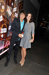 RONNIE WOOD and his wife SALLY HUMPHREYS at A Night of Funk & Soul in aid of Save The Children held at The Roundhouse, Camden, London on 20th March 2013.