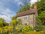 Attractive old country cottage and garden, Mells, Somerset, England, UK