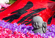 A little monk statue is decorated with flowers at Hsi Lai Temple on February 8, 2013 in Los Angeles, California, ahead of the Lunar New Year. Preparations continue for the Lunar New Year which will celebrate the Year of the Snake on February 10.  (Photo by Ringo Chiu/PHOTOFORMULA.com).