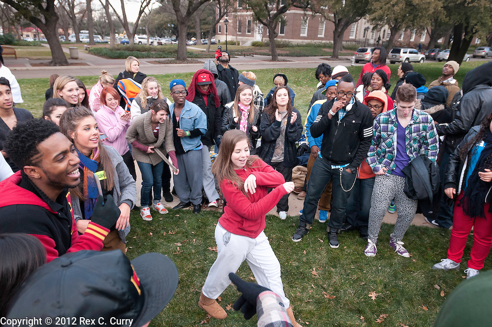 "Sarah Macaluso, 18, from the Woodlands, Tx.. is filmed for a production crew while waiting in the early morning cold to audition for ""So You Think You Can Dance"" at SMU on Friday, Jan. 13, 2012."