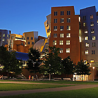 "Cambridge, MA summer night photography of the Ray and Maria Stata Center with the red Mark di Suvero sculpture, Aesops Fables II. The Stata is a Massachusetts Institute of Technology academic complex designed by Pitzker Prize winning architect Frank Gehry. Building 32 is controversy among architects and while some think it is an architectural disaster, Boston Globe architecture columnist Robert Campbell wrote a glowing appraisal of the building in 2004 stating ""The Stata is always going to look unfinished. It also looks as if it's about to collapse. Columns tilt at scary angles. Walls teeter, swerve, and collide in random curves and angles. Materials change wherever you look: brick, mirror-surface steel, brushed aluminum, brightly colored paint, corrugated metal. Everything looks improvised, as if thrown up at the last moment. That's the point. The appearance of the Stata is a metaphor for the freedom, daring, and creativity of the research that's supposed to occur inside it.""<br />