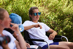Alexis Ryan (USA) relaxes in the shade at Giro Rosa 2018 - Stage 1, a 15.5 km team time trial in Verbania, Italy on July 6, 2018. Photo by Sean Robinson/velofocus.com