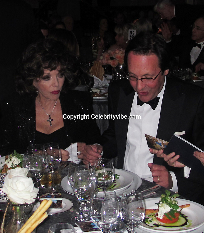 Joan Collins and Percy Gibson..Annual UNICEF Ball..Beverly Wilshire Hotel..Beverly Hill, CA, USA..Thursday, December 08, 2011..To license this image please call (323) 325-4035; or.Email: CelebrityVibe@gmail.com ; .website: www.CelebrityVibe.com