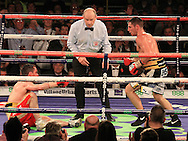 Picture by Richard Gould/Focus Images Ltd +44 7855 403186<br /> 02/11/2013<br /> Coyle (black &amp; Gold) knocks out Simpson (Red) at Hull Ice Arena, Hull.