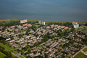 Nederland, Groningen, Delfzijl, 08-09-2009; Delfzijl Noord, woonwijk gelegen direct achter de zeedijk (Deltadijk), flats en eengezinswoningen..Delfzijl Noord, residential area directly behind the seawall (Delta Dijk), flast and individual houses..luchtfoto (toeslag); aerial photo (additional fee required); .foto/photo Siebe Swart
