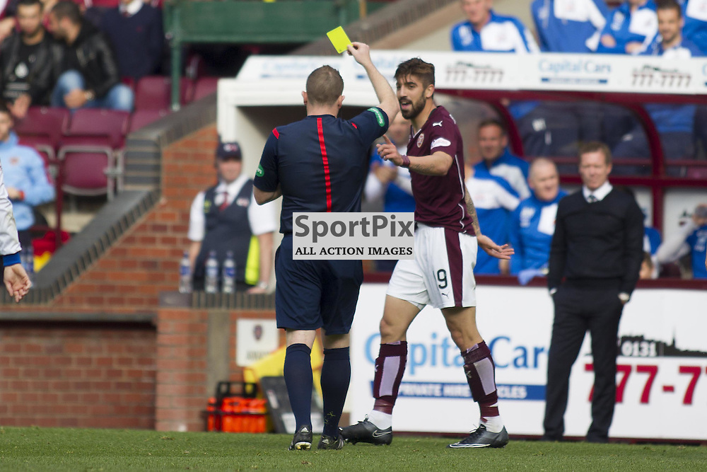 Soufian El Hassnaoui of Hearts gets a yellow card from referee John Beaton during the Ladbrokes Scottish Premiership match between Heart of Midlothian FC and Kilmarnock FC at Tynecastle Stadium on October 3, 2015 in Edinburgh, Scotland. Photo by Jonathan Faulds/SportPix