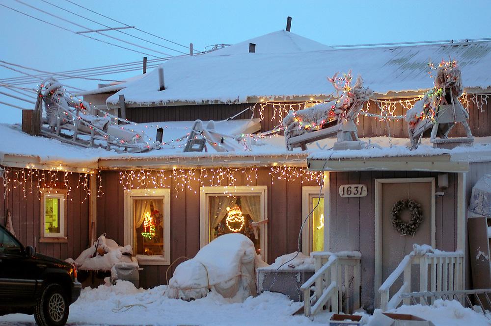 Alaska, Barrow. Whaling captain David Leavitt's house with Christmas lights decorations. December 2003