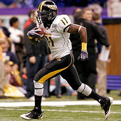 Dec 20, 2009; New Orleans, LA, USA; Southern Miss Golden Eagles running back Tory Harrison (11) runs with the ball during warm ups prior to kickoff of the 2009 New Orleans Bowl against the Middle Tennessee State Blue Raiders at the Louisiana Superdome.  Mandatory Credit: Derick E. Hingle-US PRESSWIRE
