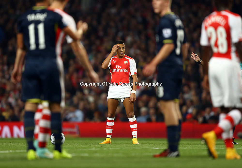 23 September 2014 - Capitol One Cup - Third Round  - Arsenal v Southampton - Alexis Sanchez of Arsenal hitches up his shorts prior to scoring the opening goal from a free kick - Photo: Marc Atkins / Offside.